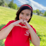 Carina making a heart with her hands